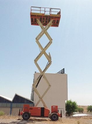 plataforma de tijera JLG 4394 RT, 15 metros diésel en alquiler